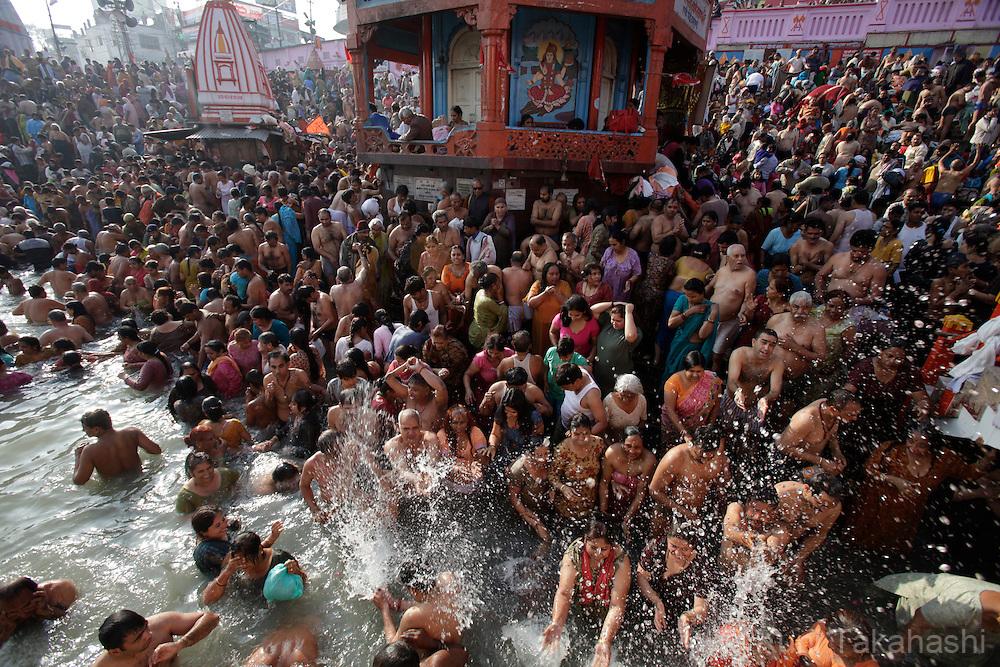 Pilgrims at holy Ganga River in Haridwar, India on Jan 2010 during Kumbh Mela, largest Hindu gathering in the world.<br /> Photo by Kuni Takahashi