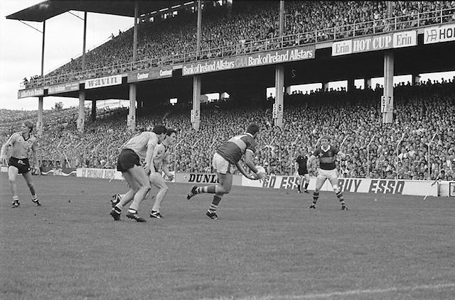 Kerry palms the ball towards team mate during the All Ireland Senior Gaelic Football Championship Final Kerry v Dublin at Croke Park on the 22nd September 1985. Kerry 2-12 Dublin 2-08.