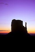 Mitten Butte silhouetted against dawn sky, Monument Valley Navajo Tribal Park, Arizona