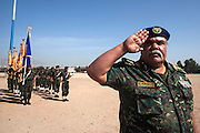 A Yemen Central Security Forces (CSF) officer directs a color guard for a troop review April 14, 2010 on the parade grounds at the CSF headquarters in the Yemeni capital, Sana'a. Yemen faces a number of security problems including the Houthi rebellion in the north, separatists in the south and Al Qaeda in the Arabian Peninsula, but is taking steps to rapidly train and deploy a variety of security forces with the help of the USA, the UK, and other governments.