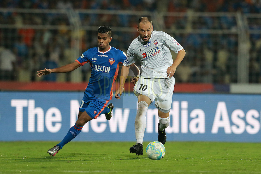 Mandarrao Dattarao Dessai of FC Goa and Jesus Rodriguez Tato of FC Pune City in action during match 8 of the Indian Super League (ISL) season 3 between FC Goa and FC Pune City held at the Fatorda Stadium in Goa, India on the 8th October 2016.<br /> <br /> Photo by Vipin Pawar / ISL/ SPORTZPICS