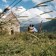 A couple visiting the chapel at small abbey in the village of Abano in the Truso Valley, near the border with occupied territory of South Ossetia in the Mtskheta-Mtianeti region of Georgia. The entire valley is all but abandoned, and for most of the year is home only to a lone homesteader, a monk, and four nuns and a priest who live in the abbey. On Sundays, the faithful visit the chapel, often on their way to see the ruins of the medieval fortress of Zakagori which lie near the abbey.