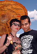A Rockabilly couple posing with an oriental umbrella, Viva Las Vegas Festival, Las Vegas, USA 2006.