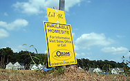 BUCKINGHAM, PA - AUGUST 24: A sign announces an available lot for building a new home at the Windsor Square development August 24, 2006 in Buckingham, Pennsylvania. New home sales dropped 4.3 percent in July, which was a bigger drop the economists had forecast in the slowing real estate market. (Photo by William Thomas Cain/Getty Images)