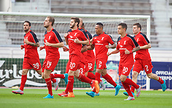 HELSINKI, FINLAND - Friday, July 31, 2015: Liverpool's players warm up before a friendly match against HJK Helsinki at the Olympic Stadium. Danny Ings, captain Jordan Henderson, Adam Lallana, Nathaniel Clyne, Philippe Coutinho Correia, James Milner. (Pic by David Rawcliffe/Propaganda)