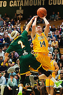 Vermont's Cam Ward (14) leaps over Lyndon's Eric Vargas (2) to take a shot during the men's basketball game between the Lyndon State Hornets and the Vermont Catamounts at Patrick Gym on Saturday afternoon November 19, 2016 in Burlington (BRIAN JENKINS/for the FREE PRESS)
