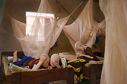 Students study in their dormitory at the Kabanga Protectorate Center and School in Tanzania. Many children with albinism suffer from failing vision, but at the center in Kabanga, some of their materials are in Braille.