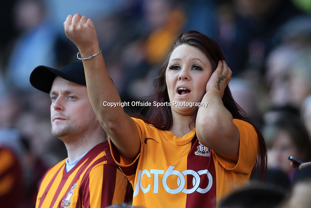 7th March 2015 - FA Cup - Quarter-Final - Bradford City v Reading - A Bradford fan gestures towards the visiting supporters - Photo: Simon Stacpoole / Offside.