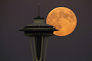 A super full moon rises over the Seattle skyline.<br />