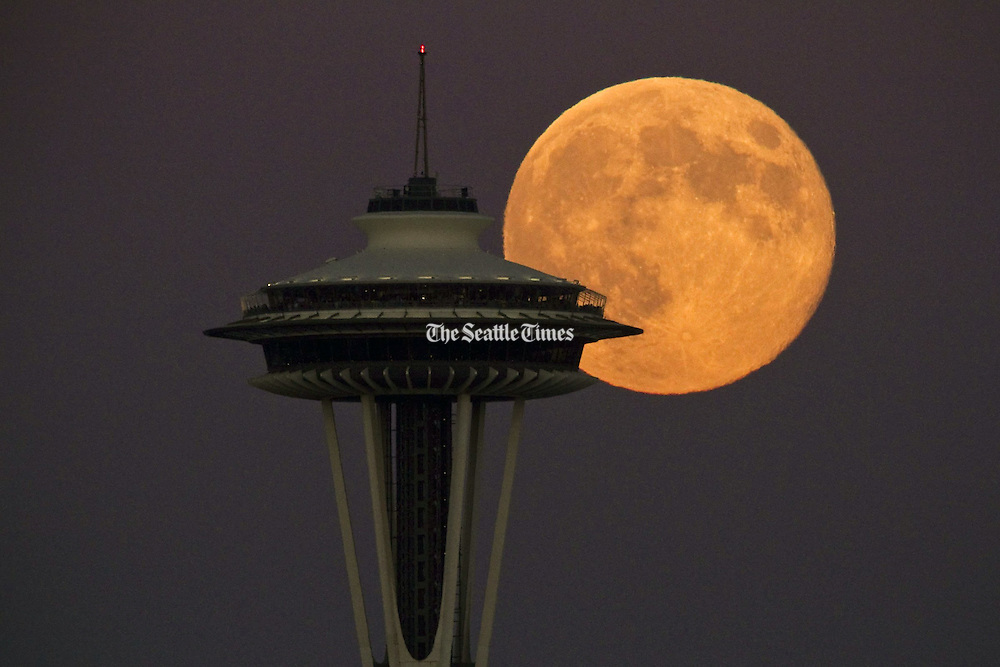 A super full moon rises over the Seattle skyline.<br /> Bettina Hansen / The Seattle Times