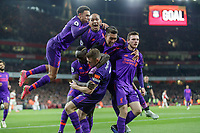 Football - 2018 / 2019 Premier League - Arsenal vs. Liverpool<br /> <br /> Liverpool players congratulate goal scorer James Milner (Liverpool FC) as they celebrate in front of their fans at The Emirates.<br /> <br /> COLORSPORT/DANIEL BEARHAM