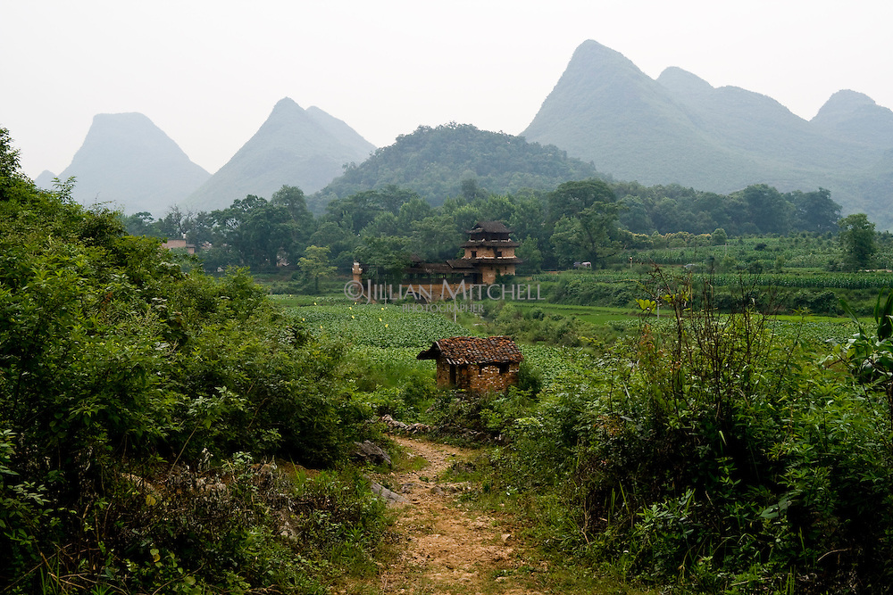 Wind and rain bridge in the fields of Fuchuan Yao Autonomous region, Guangxi, China.