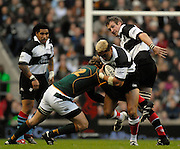 Twickenham, GREAT BRITAIN, Baa Baa's, Jerry COLLINS, attacking run is countered by the Springboks  Francois STEYN, during the, Gartmore Challenge -  Barbarians vs South Africa, rugby match at Twickenham Stadium, ENGLAND.  [Mandatory Credit Peter Spurrier/Intersport Images].