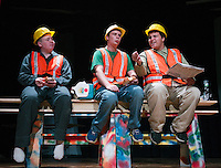 "Three construction workers ""Charlie"" Shawn Zappala, ""Frank"" Michael VonGeorge and ""Joe"" Quincy Morris take their lunch hour on the girder during dress rehearsal for ""Mere Mortals"" at Laconia High School Monday afternoon.  (Karen Bobotas/for the Laconia Daily Sun)"