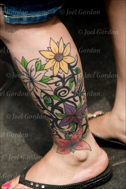 Flower tattoo on back of right leg.<br /> <br /> Body art or tattoos has entered the mainstream it is known longer considered a weird kind of subculture.