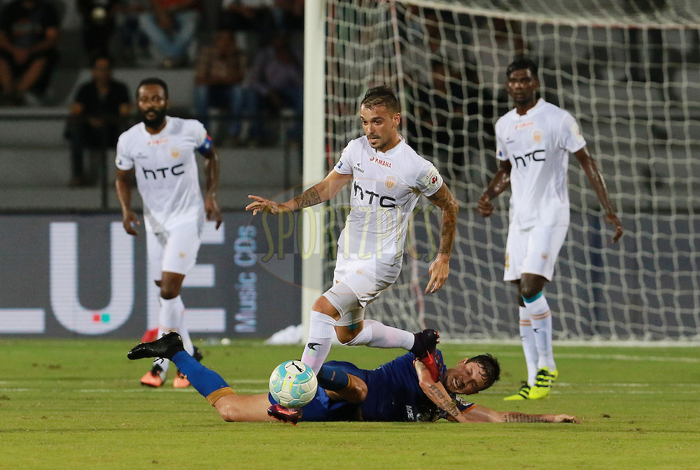Emiliano Alfaro of NorthEast United FC gets past Leonardo Fabricio Soares Da Costa of Mumbai City FC during match 7 of the Indian Super League (ISL) season 3 between Mumbai City FC and NorthEast United FC held at the Mumbai Football Arena in Mumbai, India on the 7th October 2016.<br /> <br /> Photo by Vipin Pawar / ISL/ SPORTZPICS