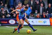 Wycombe Wanderers defender Jason McCarthy challenged by Luton Town defender Matthew Person during the EFL Sky Bet League 1 match between Luton Town and Wycombe Wanderers at Kenilworth Road, Luton, England on 9 February 2019.