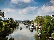15 FEBRUARY 2015 - BANGKOK, THAILAND: Boats on Khlong Bangkok Yai, one of the larger khlongs (canals) in the Thonburi section of Bangkok. Khlong Bangkok Yai runs close to the north edge of the Kudeejeen neighborhood.       PHOTO BY JACK KURTZ