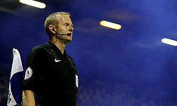 The Linesman is surrounded by blue smoke as a flare is set off during Bury v Bolton Wanderers - Mandatory by-line: Robbie Stephenson/JMP - 24/10/2016 - FOOTBALL - Gigg Lane - Bury, England - Bury v Bolton Wanderers - Sky Bet League One