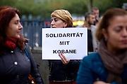 Frankfurt am Main | 08 Oct 2014<br /> <br /> Am Mittwoch (08.10.2014) nahmen an der Konstablerwache in der Innenstadt von Frankfurt am Main etwa 100 Menschen an einer Kundgebung f&uuml;r Solidarit&auml;t mit der von IS (ISIS, ISIL, Islamischer Staat) angegriffenen Stadt Kobane (auch: Ain al-Arab) teil. Die kundgebung verlief friedlich, es kam nur zu einer kleinen St&ouml;rung durch einen jungen Moslem, der sich durch einen Redebeitrag in seinem Glauben beleidigt f&uuml;hlte.<br /> Hier: Eine junge Frau mit einem Transparent mit der Aufschrift &quot;Solidarit&auml;t mit Kobane&quot;.<br /> <br /> &copy;peter-juelich.com<br /> <br /> [No Model Release | No Property Release]