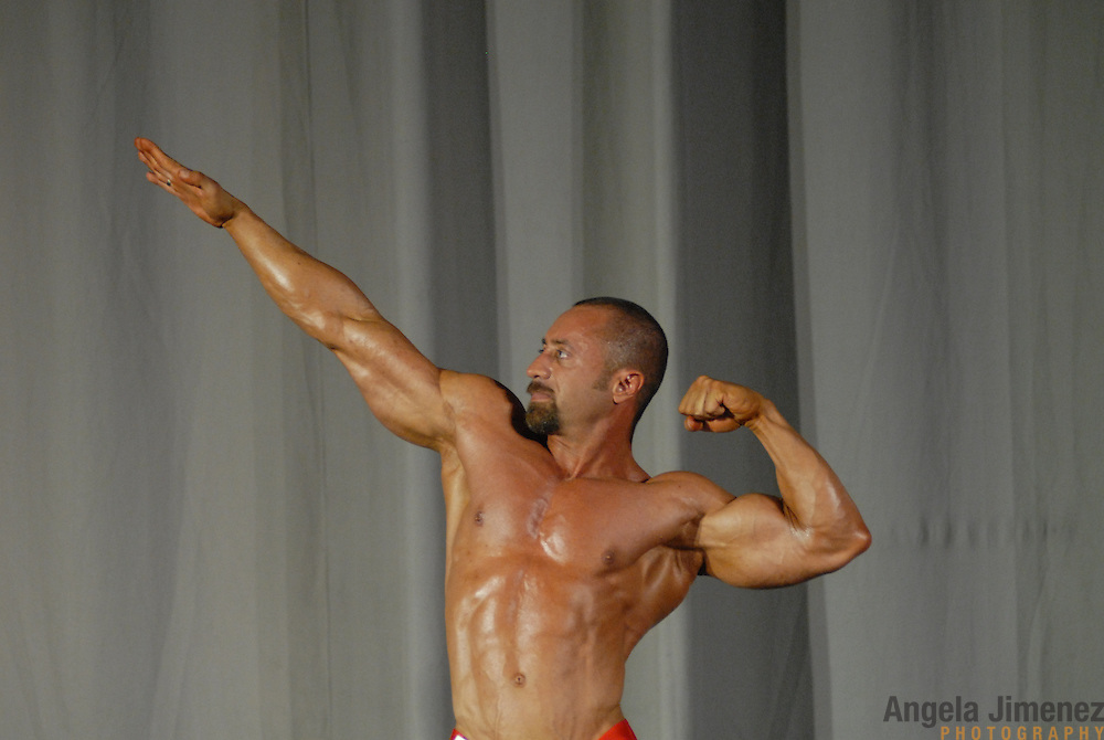 Michael Ferro, of Chicago, Illinois, poses during the Physique (bodybuilding) competition 40-49 year old age group lightweight division at McGaw Memorial Hall/Welsh-Ryan Arena at Northwestern University in Evanston, Illinois during the Gay Games VII competition on July 19, 2006. <br />  <br /> <br /> Ferro was the runner-up modified champion in his division. <br /> <br /> Over 12,000 gay and lesbian athletes from 60 countries are in Chicago competing in 30 sports during the Games from July 15 through 22, 2006. <br /> <br /> Over 50,000 athletes have competed in the quadrennial Games since they were founded by Dr. Tom Wadell, a 1968 Olympic decathlete, and a group of friends in San Francisco in 1982, with the goal of using athletics to promote community building and social change. <br /> <br /> The Gay Games resemble the Olympics in structure, but the spirit is one of inclusion, rather than exclusivity. There are no qualifying events or minimum or maximum requirements.<br /> <br /> The Games have been held in Vancouver (1990), New York (1994), Amsterdam (1998), and Sydney (2002).