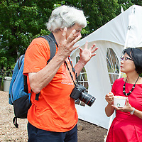 Toronto Mayoral candidate, Olivia Chow, talks with visitors at the Black Creek Community Farm Festival -- June 26, 2014