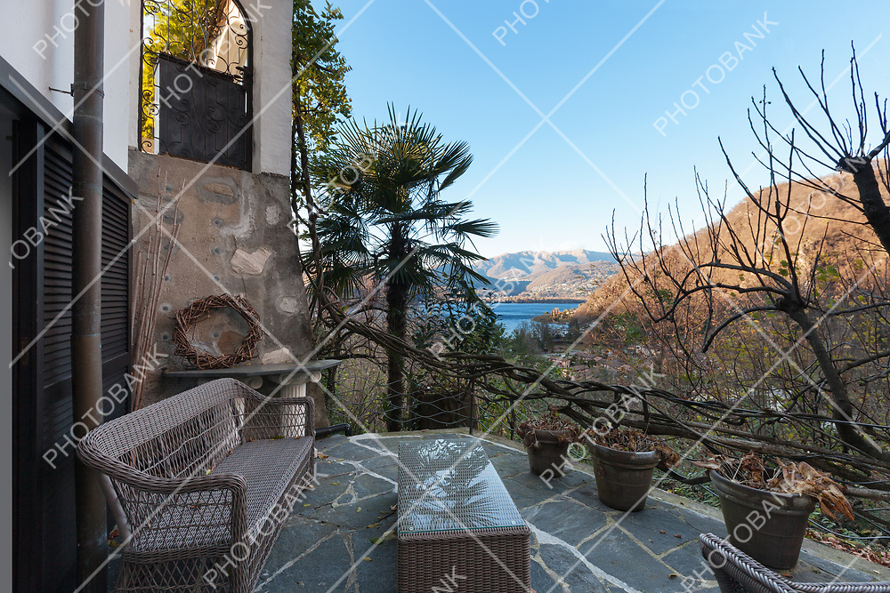House, nice terrace with garden furniture, flooring stone