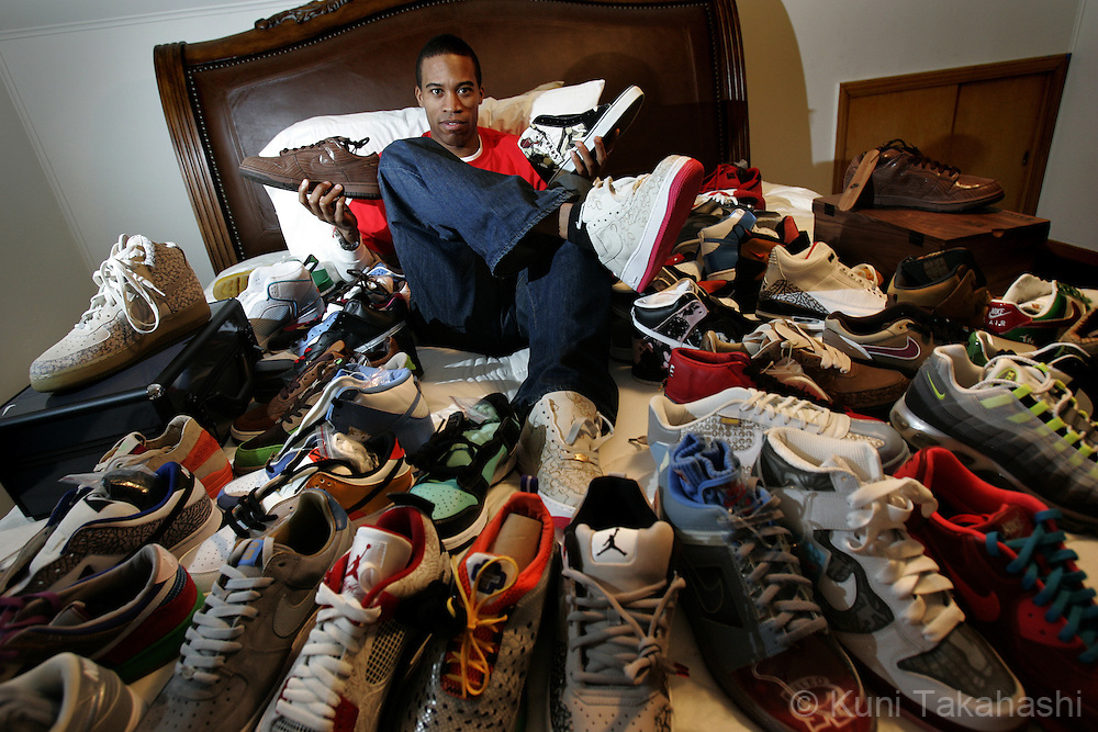 Shoe collector Anton Murphy poses with his rare sneaker collections at his house in Chicago on  Jan 14, 2007.