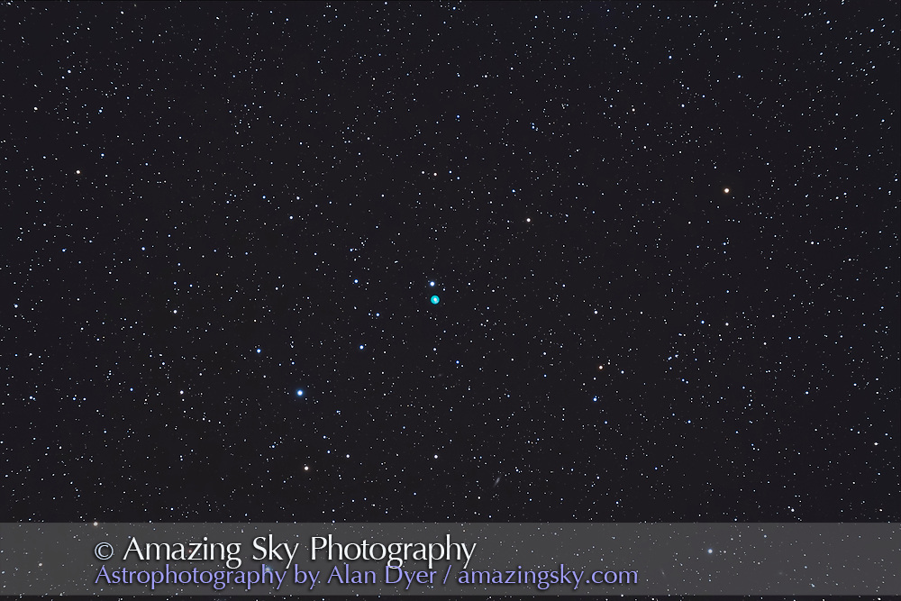 The Eskimo or Clown Face Nebula, aka NGC 2392, in Gemini. Taken from home March 1, 2013, under excellent conditions, using the AP 130mm apo at f/6, no field flattener and the Canon 60Da at ISO 800 for a stack of 4 x 8 minute exposures, all on the Sky-Watcher AZ-EQ6 mount in for testing, and the Starshoot autoguider with PHD Guiding 1.14 software. It all worked great. The camera shutter was controlled by the telescope hand controller. The little galaxy at bottom is UGC 3873 at Mag. 14.4.