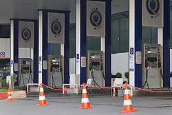 © Licensed to London News Pictures. 26/06/2014. Sulaimaniyah, Iraq. A chained off petrol station, closed due to lack of fuel earlier in the day is seen in Sulaimaniyah, Iraqi-Kurdistan. Despite being an oil-rich country Iraq's main oil refinery at Baiji is now the hands of ISIS insurgents cutting much of the fuel to the rest of the country. Petrol rationing has come in to force across northern Iraq with huge queues that mean many drivers wait in line for hours, sometimes overnight, just to receive their allowance of 30 litres. The shortage has also seen a huge increase in fuel prices with a litre of petrol rising 150% from 500 Iraqi Dinars to 1500 Iraqi Dinars. Photo credit: Matt Cetti-Roberts/LNP