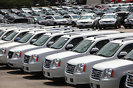 General Motors autos and trucks sit in an auto storage lot in Alexandria, Virginia, photo by Dennis Brack