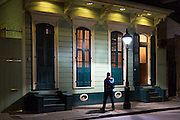 Man walks in residential neighbourhood on Bourbon Street in French Quarter of New Orleans, Louisiana, USA