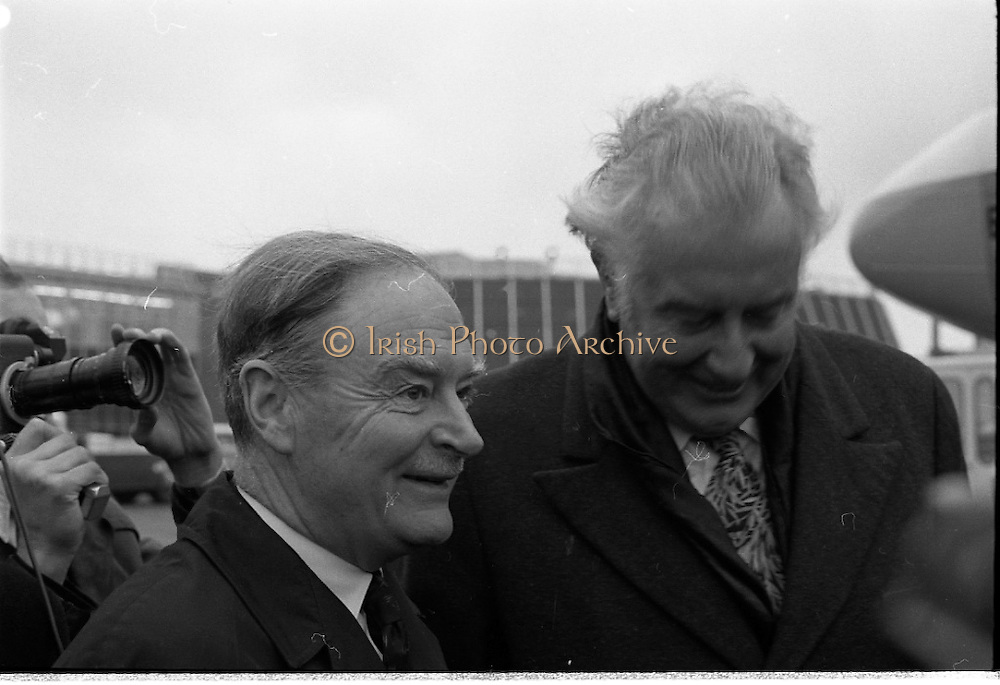 Australian Prime Minister Visits Ireland.   (H79)..1974..23.12.1974..12.23.1974..23rd December 1974..As part of his tour of E.E.C. Capital Cities,Mr Gough Whitlam, the Australian Prime Minister visited Dublin today. In Dublin he will have talks with An Taoiseach, Mr Liam Cosgrave...Picture of The Australian Prime Minister, Mr Gough Whitlam, being greeted on the tarmac by An Taoiseach, Mr Liam Cosgrave.
