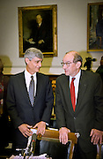 Federal Reserve Chairman Alan Greenspan talks with Secretary of the Treasury Robert Rubin before the start of House Banking hearings May 20, 1999 in Washington, DC.