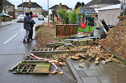 © Licensed to London News Pictures. 28/03/2016<br /> This Orpington couple have lost 40 meters of their garden wall to the storm, they are now waiting for the council and insurance to assess the damage.<br /> Storm Katie damage in Kent.<br /> Winds up to 80 mph have battered the UK over night.<br /> <br />  (Byline:Grant Falvey/LNP)