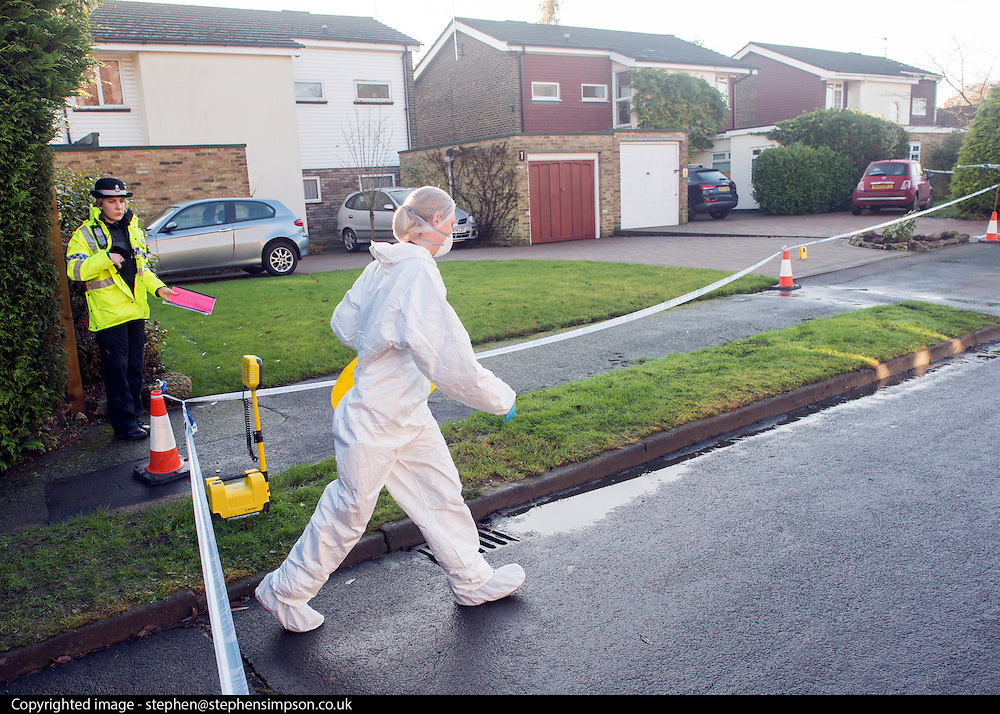 © Licensed to London News Pictures. 27/11/2014. Fetcham, UK. Forensic officers at the scene.  A manhunt is under way across two counties after a man and woman were found stabbed to death in Surrey. The bodies were found at a house in Fetcham, near Leatherhead, after Surrey Police were alerted in the early hours.. Photo credit : Stephen Simpson/LNP