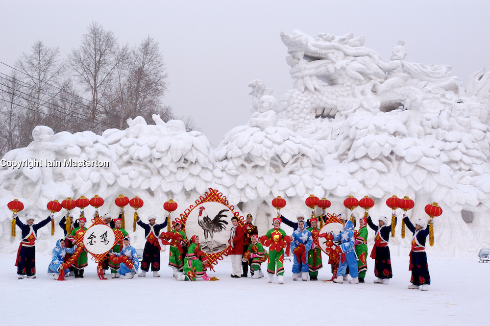 Snow sculptures and people in traditional dress at annual snow sculpture festival in Harbin China