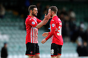 Exeter City's Jamie McAllister celebrates the visitors 2-0 win with Exeter City's 2nd goal scorer Jake Taylor after the final whistle in the Sky Bet League 2 match between Yeovil Town and Exeter City at Huish Park, Yeovil, England on 9 April 2016. Photo by Graham Hunt.