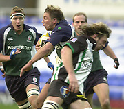 14/12/2003 - Photo  Peter Spurrier.2003/04 Parker Pen Challenge  Cup: London Irish vs Montauban.Exiles Justin Bishop. slips the tackle from Montauban Skipper Serge Serueev   [Mandatory Credit, Peter Spurier/ Intersport Images].
