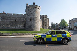 © Licensed to London News Pictures. 10/04/2020. Windsor, UK. Police patrol around Windsor Castle, normally a tourist hotspot, deserted of people on Good Friday, during a pandemic outbreak of the Coronavirus COVID-19 disease. The public have been told they can only leave their homes when absolutely essential, in an attempt to fight the spread of coronavirus COVID-19 disease. Photo credit: Ben Cawthra/LNP