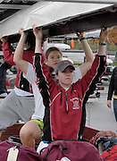 Boston, Massachusetts, USA.Bates Rowing unload their shell from the trailer.  Boat racks/storage areas, boat trailers and trucks. Fri morning,  20/10/2006,   2006 Head of the Charles,  Photo  Peter Spurrier/Intersport Images...[Mandatory Credit, Peter Spurier/ Intersport Images] Rowing Course; Charles River. Boston. USA