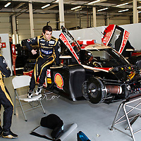 Nicolas Prost climbs aboard the no.12 Rebellion car to check the seating, as Nick Heidfeld looks on, FIA WEC 2013 6h of Silverstone