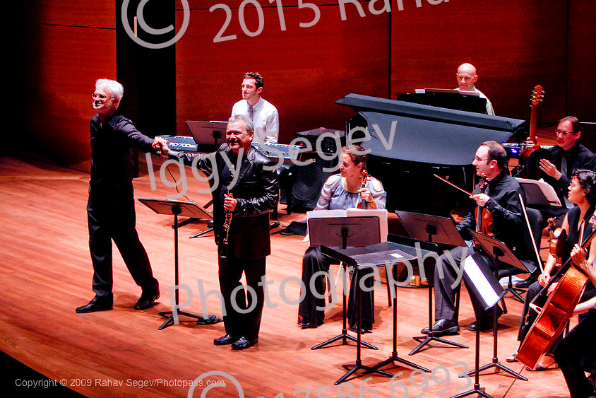 John Adams conducts with Michael Collins on Clarinet at Alice Tully Hall on August 17, 2009. .They performed Gnarly Buttons with The International Contemporary Ensemble.