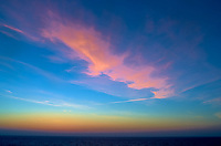 Pink clouds at dawn over the Atlantic Ocean from the deck of the MV Explorer. Image taken with a Leica X2 camera.