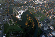 "The Napa River forms an oxbow in downtown Napa, as seen in this March 13, 2004 aerial photo. The bends in the river present flooding problems in heavy rains. Napa's unique ""Living River"" flood control project allows water to flow in its historical channel, creating wetlands, restoring the life of the river, and protecting property from floods."