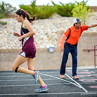 """042915  Adron Gardner/Independent<br /> <br /> Ramah Mustang Povi Becker runs the girls 3200m race during the district 1-2A track meet in Ramah Friday. Becker finished with a time of 13'58""""."""