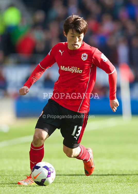 CARDIFF, WALES - Saturday, March 22, 2014: Cardiff City's Kim Bo-Kyung in action against Liverpool during the Premiership match at the Cardiff City Stadium. (Pic by David Rawcliffe/Propaganda)