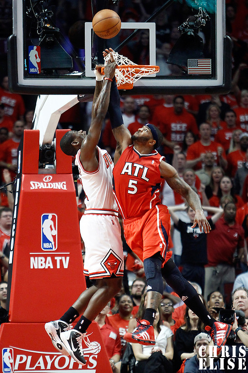 10 May 2011: Atlanta Hawks power forward Josh Smith (5) illegally blocks Chicago Bulls shooting guard Ronnie Brewer (11) during the Chicago Bulls 95-83 victory over the Atlanta Hawks, during game 5 of the Eastern Conference semi finals at the United Center, Chicago, Illinois, USA.