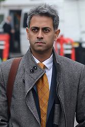 © Licensed to London News Pictures.10/12/2013. London, UK. Rahul Gajjar, finance director for Charles Saatchi arrives at Isleworth Crown Court in London.Photo credit : Peter Kollanyi/LNP