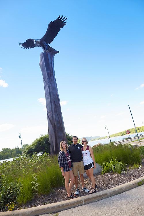 Activity; Socializing; Buildings; Downtown; Location; Outside; People; Woman Women; Man Men; Student Students; Summer; June; Time/Weather; day; Type of Photography; Candid; Lifestyle; UWL UW-L UW-La Crosse University of Wisconsin-La Crosse; Eagle Statue; Riverside Park